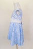 Fully lined pale blue sequined lace dress has cap sleeves & white  sash that ties in bow at back. Comes with matching sequined hair accessory. Left side