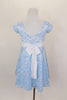Fully lined pale blue sequined lace dress has cap sleeves & white  sash that ties in bow at back. Comes with matching sequined hair accessory. Back