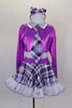 Crystal covered purple metallic half-top has keyhole back, white glitter collar & attached tartan neck tie. The matching tartan skirt has petticoat & ruffle.  Comes with tartan socks and headband. Front