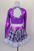 Crystal covered purple metallic half-top has keyhole back, white glitter collar & attached tartan neck tie. The matching tartan skirt has petticoat & ruffle.  Comes with tartan socks and headband. Back