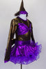 Brown shiny leotard with keyhole back has large purple bow bust. Purple skirt has curly ruffle edge & large bow at back with tail. Has pointy party hat with fuzzy ears.  Side