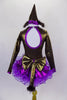 Brown shiny leotard with keyhole back has large purple bow bust. Purple skirt has curly ruffle edge & large bow at back with tail. Has pointy party hat with fuzzy ears. Back