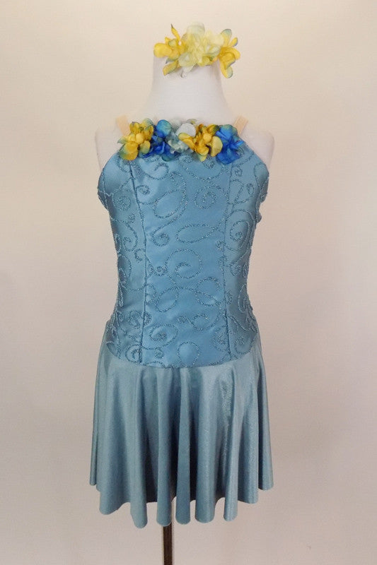 Saddened blue lyrical dress has princess cut bodice with textured paisley swirls and faded flower blossoms on bust. Comes with matching hair accessory. Front