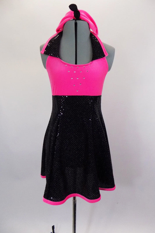 Empire waist, black sequin dress has neon pink velvet halter bodice with black sequin lapels, crystal accented front as well as pink binding & matching headband. Front