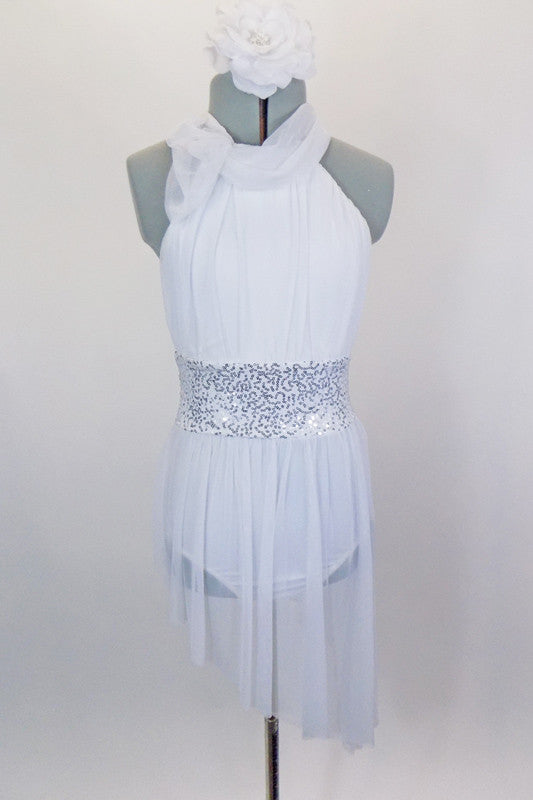White mesh covers the white leotard base of dress. Sheer mesh shawl collar wraps around gathered halter neckline. Has silver sequin waistband & hair accessory. Front