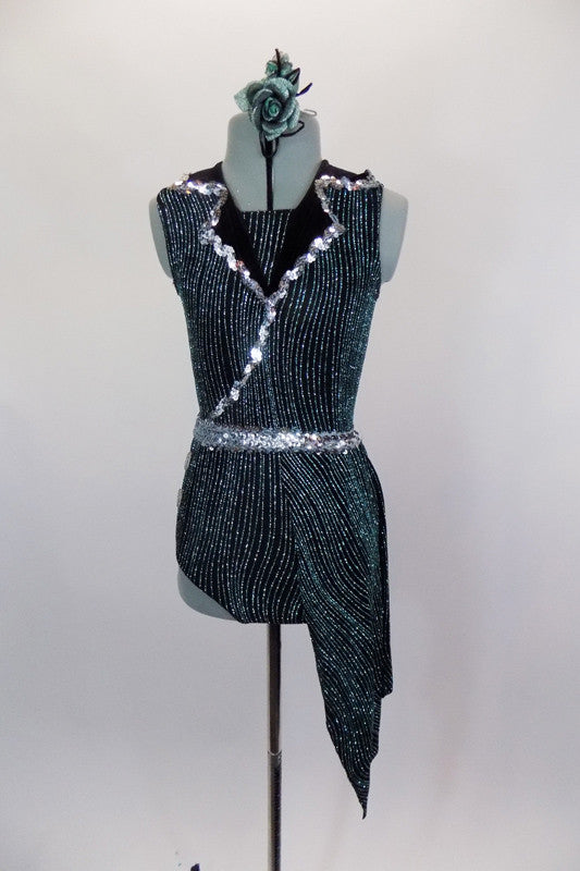 Semi sheer black leotard has keyhole back, swirls of metallic green & black velvet lapels with silver edging. Comes with angled side skirt, silver sequined belt & hair accessory. Front