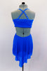 Bright blue mesh dress has crystaled straps and gathered, lined cross-over bust with  crystal brooch. Bust is attached to skirt gathered at front & open at back. Comes with crystal barrette. Back