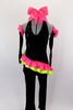 2-piece black velvet costume has asymmetrical top with pink & green ruffles & crystals. Comes with black velvet pants & long velvet gloves with pink ruffle.  Comes with bow hair accessory. Front