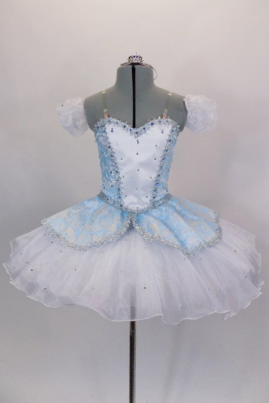 Blue leotard base has separate blue damask bodice with front insert & silver braiding. Tutu overlay is crystal covered white organza with matching blue damask. Comes with crystal tiara. Front.