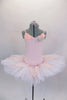 Blush pink, lace princess bodice, with crystals is attached to 8 layer pleated, tacked tutu with panty & hook-eye back. Lace overlay has pink crystaled flowers. Comes with Swarovski bridal headband. Front