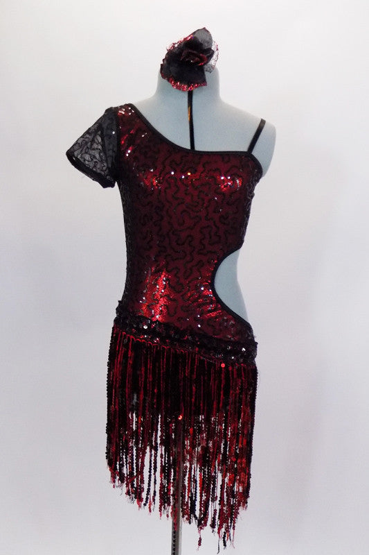 One shoulder sequin fringe dress has red base & black sequined lace overlay. Right side has lace capped sleeve and left side is open. Has sequin fringe skirt and hair accessory. Front