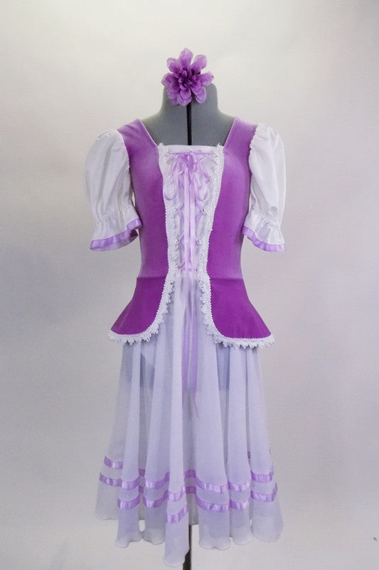Purple velvet peplum bodice with crochet lace has white center panel that laces at front & white pouf sleeves. White chiffon skirt has lavender ribbon accents. Comes with lavender floral hair accessory. Front