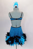 Turquoise sequined dress has feather trim at skirt bottom. Sides are completely open with large crystal buckle accent at bust. Comes with feather hair accessory. Back