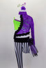 Black & white striped unitard has one long & one short leg with purple & black hip bustle. It's attached to purple lace asymmetrical shrug with green bra below. Comes with hair accessory. Front