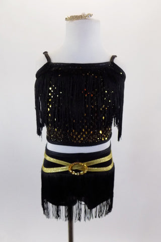 Black & gold 2-piece costume has open back half top with black fringe. The  briefs have fringe on hip & gold belt. Comes with gold and crystal hair accessory. Front