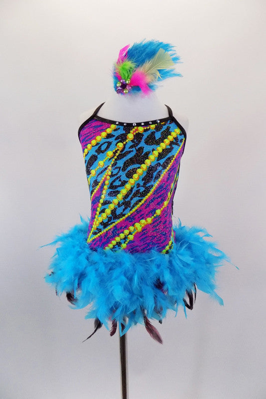 Mardi Gras themed open straped back costume is a colorful leotard with pearls & beads print. The skirt is made entirely of layers of purple & turquoise feathers. Comes with feather hair accessory. Front
