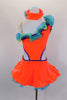 Bright orange velvet one-shoulder dress has open sides with purple crystals. Curly hem ruffles in lime, turquoise & purple accent the neckline & petticoat edge. Comes with ruffled gauntlets and floral headband. Back