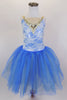 Ivory lace and gold applique sits over top of a shiny blue leotard base with nude straps and nude center insert. Gold and blue crystal tulle, make up the attached romantic tutu. Comes with hair accessory. Front