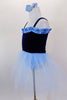 Dark blue velvet ballet dress with pale blue ruffle accent at neckline has attached pale blue tulle skirt &  panty. Comes with pale blue hair accessory. Side