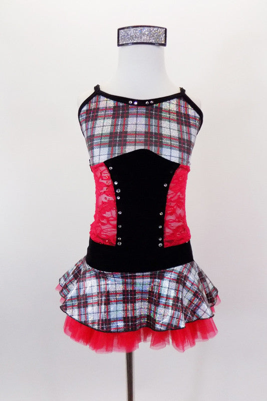 Red, black & silver tartan school-girl costume has tartan bust and skirt attached by red sequined lace torso with crystaled black velvet center and waistband. Comes with crystal air barrette. Front