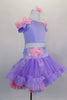 Pale lavender costume has shoulder cap sleeved top edged with crystal & satin roses along shoulder. Skirt has layers of pastel ruffles & satin rose hip accent. Comes with rose hair accessory. Right side