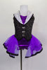 Purple leotard has black pinstripe vest bodice with white sequined lapels, large silver buttons & attached purple skirt with ribbon edge. Comes with bowler hat. Front