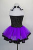 Purple leotard has black pinstripe vest bodice with white sequined lapels, large silver buttons & attached purple skirt with ribbon edge. Comes with bowler hat. Back