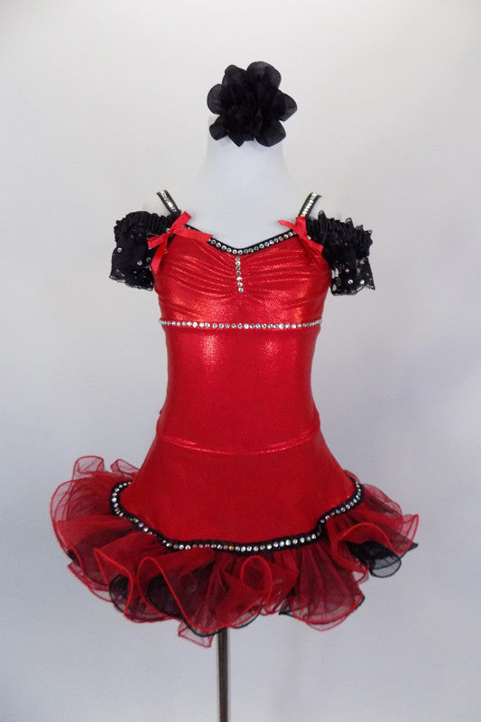 Shiny red leotard dress has crystaled bust-line, banding/straps & lace cap sleeves. Attached skirt has layers of black & red curly ruffle & black bow at back. Comes with black floral hair accessory. Front
