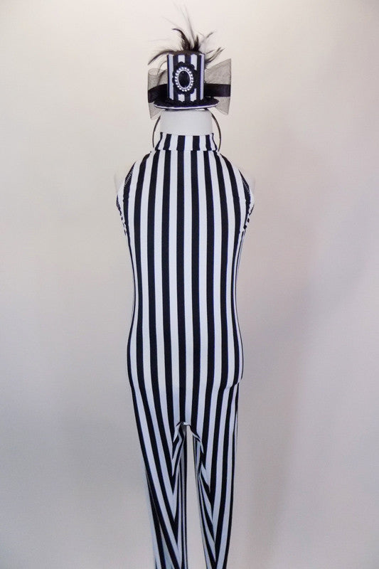 Black sleeveless unitard with high neck and open key-hole back has built in foot harness.  Comes with black and white striped top hat accessory. Front