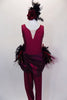 Stunning maroon lined unitard has deep front cut with nude, crystaled center insert. Waist has chiffon draping & mixed variety of feathers for back bustle over maroon gathered tulle. Comes with feather hair accessory. Front