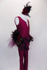 Stunning maroon lined unitard has deep front cut with nude, crystaled center insert. Waist has chiffon draping & mixed variety of feathers for back bustle over maroon gathered tulle. Comes with feather hair accessory. Right side