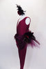 Stunning maroon lined unitard has deep front cut with nude, crystaled center insert. Waist has chiffon draping & mixed variety of feathers for back bustle over maroon gathered tulle. Comes with feather hair accessory. Left side