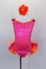 Hot pink corset style leotard dress has  lace-up back The bright orange banding is lined with crystals & open front  skirt has pink and orange curly ruffle hem. Comes with jeweled, floral hair accessory. Front