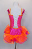 Hot pink corset style leotard dress has  lace-up back The bright orange banding is lined with crystals & open front  skirt has pink and orange curly ruffle hem. Comes with jeweled, floral hair accessory. Back