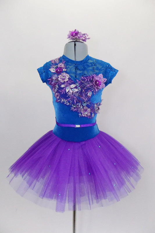 Tutu dress has teal velvet sweetheart bodice with lace upper, cap sleeves & crystaled sequin lace applique front detail, attached to pleated purple tulle skirt. Comes with appliqued hair accessory. Front
