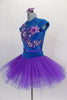 Tutu dress has teal velvet sweetheart bodice with lace upper, cap sleeves & crystaled sequin lace applique front detail, attached to pleated purple tulle skirt. Comes with appliqued hair accessory. Left side