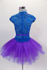 Tutu dress has teal velvet sweetheart bodice with lace upper, cap sleeves & crystaled sequin lace applique front detail, attached to pleated purple tulle skirt. Comes with appliqued hair accessory. Back