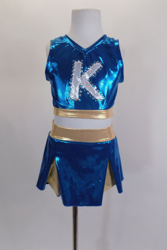 "Two piece turquoise & gold cheerleader themed costume has large crystaled ""K"" at the front & peek-a-boo hole at the back. Comes with matching pleated skort. Front"