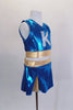 "Two piece turquoise & gold cheerleader themed costume has large crystaled ""K"" at the front & peek-a-boo hole at the back. Comes with matching pleated skort. Side"