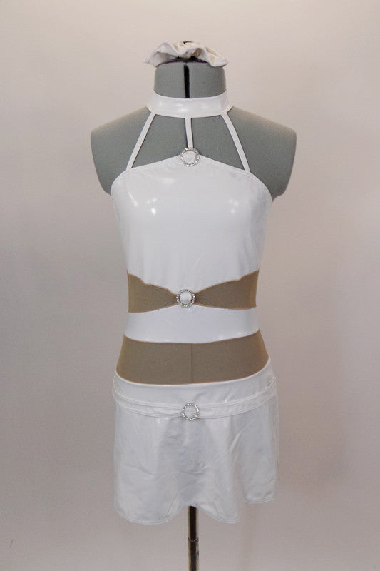 White faux leather halter leotard dress has attached skirt & choker collar with three straps that attach to the bodice. Nude sheer mesh exposes midriff. Has crystal ring accents & hair accessory. Front
