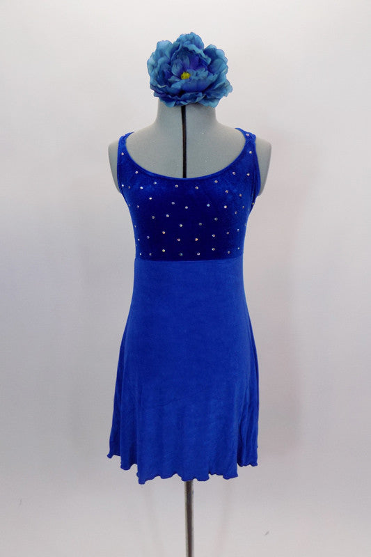 Royal blue empire waist leotard dress has crystal covered velvet bodice with double cross back straps. Skirt is a textured crepe stretch that flows nicely. Comes with large floral hair accessory. Front