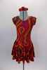 Tie-Dye style flowy tank dress with cap sleeves has scoop neck front and back in shades of reds browns & oranges create the 60s vibe. Comes with hair accessory. Front