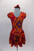Tie-Dye style flowy tank dress with cap sleeves has scoop neck front and back in shades of reds browns & oranges create the 60s vibe. Comes with hair accessory. Back
