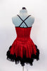 Red sequined dress has black crystal covered cross straps & black petticoat. Satin rose & feather trim edges the skirt & neckline. Comes with hair accessory. Back