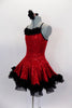 Red sequined dress has black crystal covered cross straps & black petticoat. Satin rose & feather trim edges the skirt & neckline. Comes with hair accessory. Side