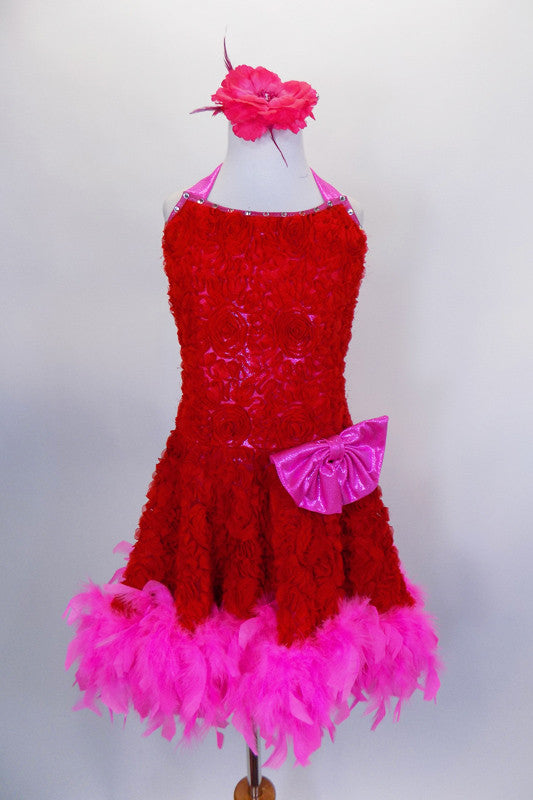 Red ribbon rose fabric halter neck dress with pink crystal covered banding & pink hip bow. The skirt is edged with pink feathers. Comes with hair accessory and long pink gloves. Front