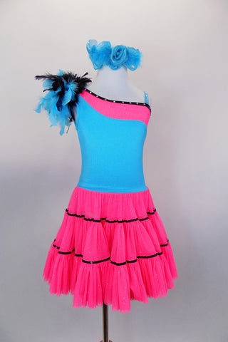 Bright neon pink glitter mesh & turquoise funky dress has gathered & ruffled layered mesh skirt has black ribbon detail, feather accent & black crystaled trim. Comes with turquoise hair accessory. Front