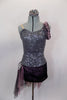 Pewter sequined camisole one shoulder dress has skirt with side-back bustle in ruffled layers of charcoal & blush mesh. Has jeweled hip accent & hair accessory. Front