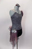 Pewter sequined camisole one shoulder dress has skirt with side-back bustle in ruffled layers of charcoal & blush mesh. Has jeweled hip accent & hair accessory. Right side