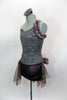 Pewter sequined camisole one shoulder dress has skirt with side-back bustle in ruffled layers of charcoal & blush mesh. Has jeweled hip accent & hair accessory. Left side